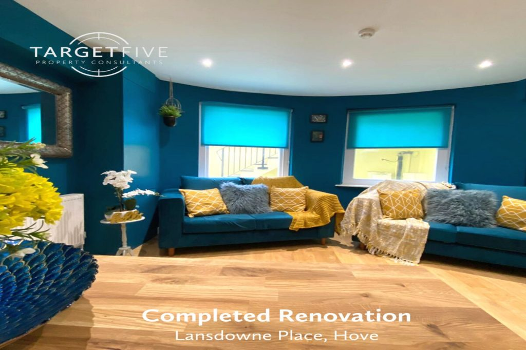 completed renovation of Lansdowne Place, Hove. Image shows the refurbished lounge area, with teal walls and blinds with new sofas to match and yellow cushions